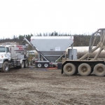 Jim River on Dalton Hwy - Setup for batching with Mobile Mixer, cement silo, water tank, and cement bulker.