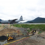 Juneau - Preparing and cleaning host pipe to receive a sliplined liner pipe in Jordan Cr under Juneau Airport.
