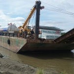 Kwethluk - Smaller barge bringing equipment and materials up the Kuskokwim River for new school.