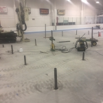 """Boeke Ice Arena - A large area about 40' in diameter in the center of the rink settled up to 3"""". Compaction grouting was used with low-mobility grout injected down to 18' to stabilize soft layers and raise the slab. Injection pipes had to inserted between coolant tubes 3"""" on center."""