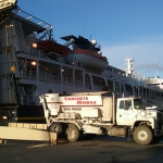 Kodiak-Volumetric mixer coming off an overnight ferry ride from Homer for KEA building lifting project.